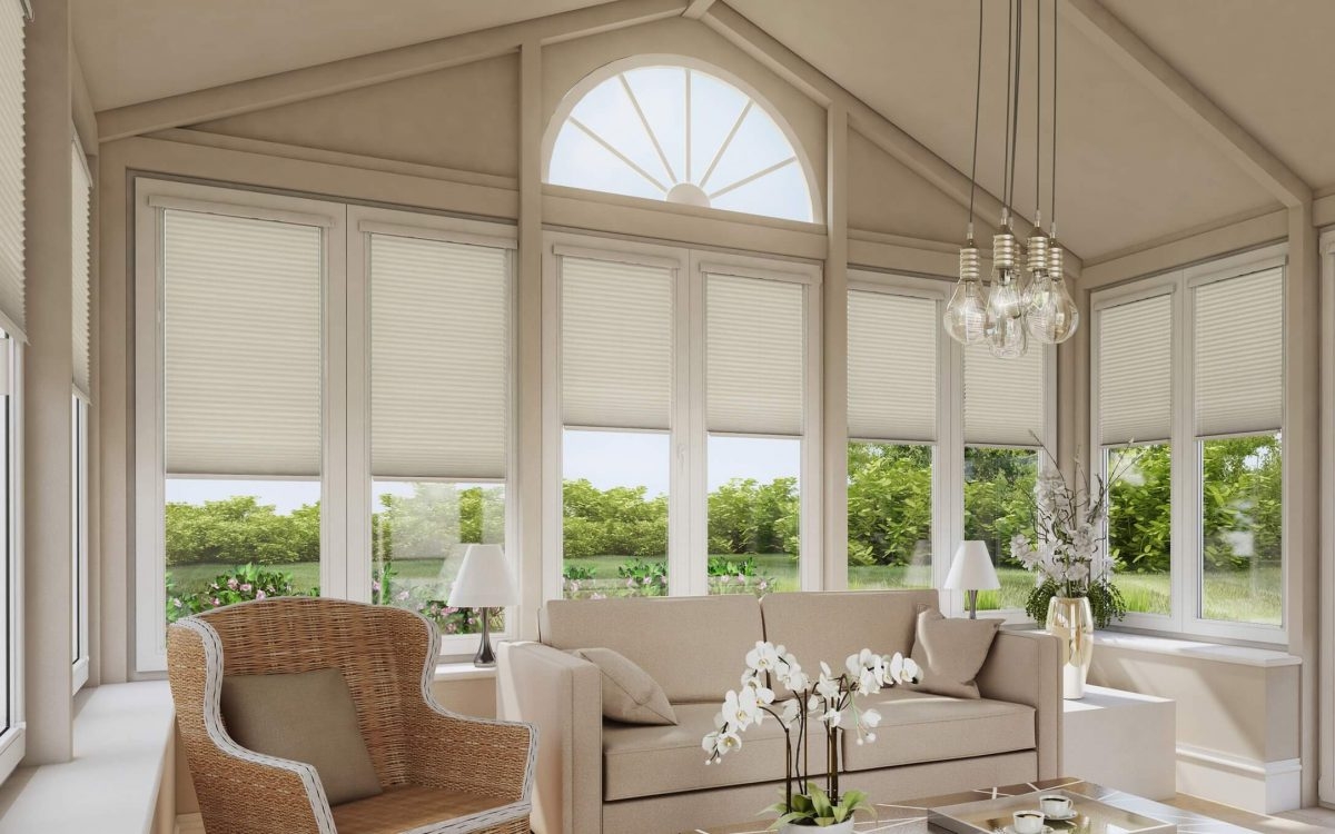 Cream white pleated blinds in conservatory windows