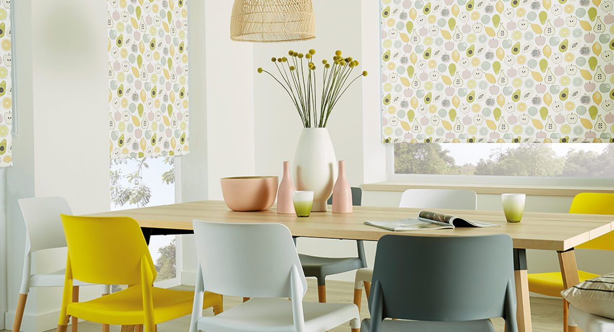 Multi-coloured pattern roller blinds in dining room